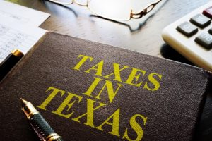 Book about Taxes in texas on an office table.